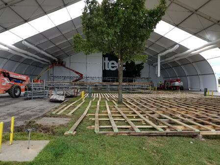 Temporary Structure with Flooring Being Set