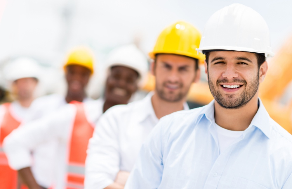 Group of engineers on building site