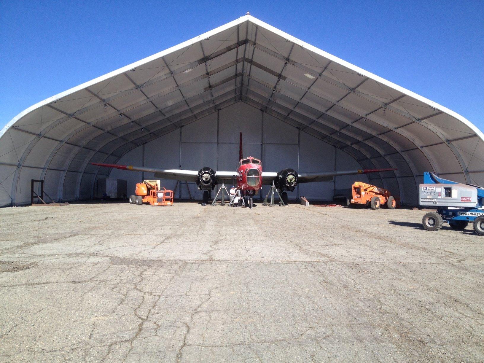 Aircraft hangar trendy airplane hangar with aircraft for Aircraft hanger designs